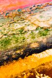 Natural texture with vivid strips. Abstract background with old colorful stains of mineral salt corrosion on grungy concrete. Close-up obsolete stone wall Royalty Free Stock Image