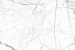 Natural texture white with a pattern of chaotic cracks stock photo