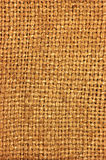 Natural textured burlap sackcloth hessian texture coffee sack dark country sacking canvas large detailed vertical macro background. Natural textured burlap Stock Photography