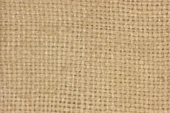 Natural textured burlap sackcloth hessian texture coffee sack, light country sacking canvas, horizontal pattern, macro background. Natural textured burlap Royalty Free Stock Photo
