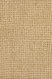 Natural textured burlap sackcloth hessian texture coffee sack, light country sacking canvas, vertical macro background pattern Royalty Free Stock Photo