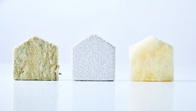 Natural textured house shapes on white background. Three natural coloured, textured house shapes isolated on a white background stock photos