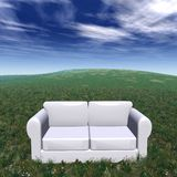 Natural theater. Withe sofa on a green grass in a sunny day Royalty Free Stock Photo