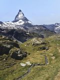 Natural Trail with view of Matterhorn Peak in summer, Zermatt, Switzerland, Europe. Family Activities, Hiking in the wild concept.  royalty free stock photo