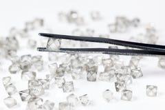 Natural  transparent diamond in tweezers Stock Photos