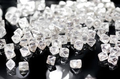 Natural transparent diamonds on a black background Stock Photography
