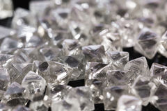 Natural transparent diamonds in macro on black background Royalty Free Stock Images