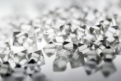 Natural transparent diamonds in macro on white Royalty Free Stock Photography
