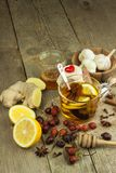 Natural treatment for colds and flu. Ginger lemon honey garlic and rosehip tea against influenza. Hot tea for colds. Home Pharmacy Royalty Free Stock Photography