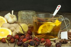 Natural treatment for colds and flu. Ginger lemon honey garlic and rosehip tea against influenza. Hot tea for colds. Home Pharmacy Stock Photo