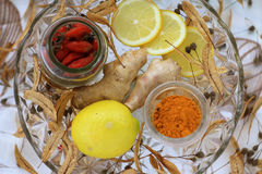 Natural treatment. Lemon,ginger,linden, turmeric. The concept of treating colds with natural resources, without tablets. canker-rose, lemon, Linden tea, turmeric Stock Photos