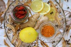 Natural treatment. Lemon,ginger,linden, turmeric Stock Photos