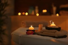 Natural treatments and alight candles. In spa salon Stock Images