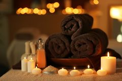 Natural treatments and alight candles. In spa salon Royalty Free Stock Photo