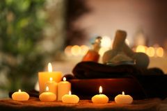Natural treatments and alight candles. In spa salon Royalty Free Stock Photos