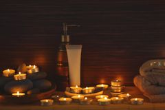 Natural treatments and alight candles. In spa salon Royalty Free Stock Image