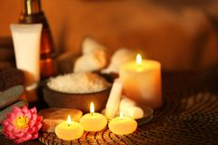 Natural treatments and alight candles. In spa salon Royalty Free Stock Photography