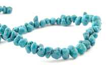 Natural turquoise beads on a white background Stock Photo