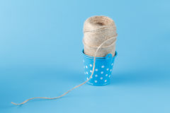 Natural twine in blue bucked Stock Photography