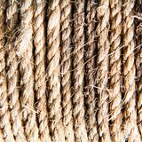 Close up of twisted braided rope detail. Natural twisted braided and coiled hemp rope for fastening. strength and security royalty free stock photos