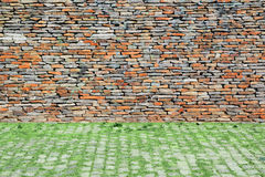 Natural urban background. Stone wall and cobbled floor Stock Photo