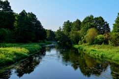 Natural view of the morning light on the lake, from the picturesque bridge, seen in tourist places. Or scenic spots in the Republic of Belarus on the Beaver royalty free stock photo