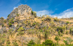 Natural view of top of rock mountain with blue sky Stock Image