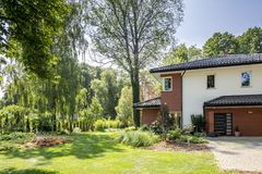 Natural view of trees and garden of modern house Royalty Free Stock Photo