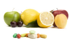 Natural vitamins. A photo of pills and multi-fruit Stock Photos