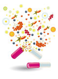 Natural vitamins are in a pill Stock Photography