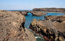 Natural volcanic formation. Channel leads to a natural arch in the volcanic formation on the bay of Salinas in Sao Jorge, Fogo, Cabo Verde Stock Photography