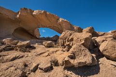 Natural volcanic rock arch formation in desertic landscape in Tenerife, Canary islands, Spain. Natural volcanic rock arch formation in desertic landscape in royalty free stock photography