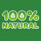 100% natural. Volumetric sticker 100% natural» ecological direction on the background pattern of leaves. Vector illustration. Ideal to use for labeling of Royalty Free Stock Photography