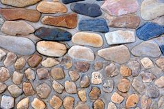 Natural wall made from rocks and stone. It is used for background and texture. Stock Photo