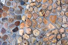 Natural wall made from rocks and stone. It is used for background and texture. Royalty Free Stock Images