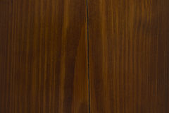 Natural walnut woodgrain texture with crack Royalty Free Stock Photography