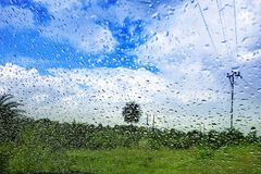 Natural water drop background.CAR Window glass with condensation. Of natural water drops .Abstract photo.Travelling and suddenly Rain breaks out giving me to Stock Images