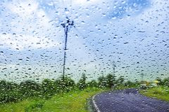Natural water drop background.CAR Window glass with condensation. Of natural water drops .Abstract photo.Travelling and suddenly Rain breaks out giving me to Royalty Free Stock Photos