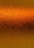 Natural Water Droplets on Bright Orange Colored Bottle, for Abstract Background with Selective Focus Stock Photos