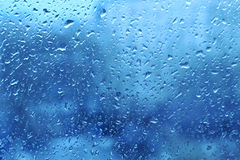 Natural water drops on window glass. Background with natural water drops on window glass Stock Photography