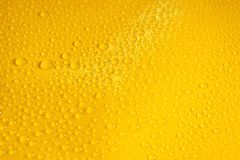 Natural water drops on yellow background texture. Golden color stock photos