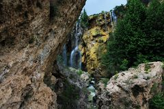 The natural waterfall is in the forest stock images