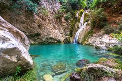 Natural waterfall and lake in Polilimnio area in Greece. Polimnio is a complex of waterfalls and lakes are located near Charavgi Municipality, Messinia royalty free stock images