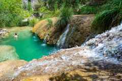 Natural waterfall and lake in Polilimnio area in Greece. Polimnio is a complex of waterfalls and lakes are located near Charavgi Municipality, Messinia stock photos