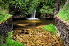 Natural waterfall. With a stream Stock Photography