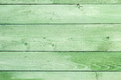 Natural weathered wooden planks background. Old painted in green Stock Image