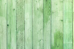Natural weathered wooden planks background. Old painted in green Stock Photos