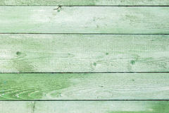 Natural weathered wooden planks background. Old painted in green Stock Photo