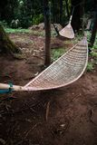 Natural weave hammock in forest. Natural weave hammock under the tree hanging in forest Royalty Free Stock Photography