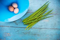 Natural white eggs in a blue bowl Stock Photo